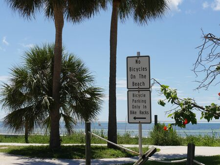 Signs on the roadside along the coastal S Roosevelt Boulevard in Key West, Florida.