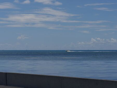 Scenic view of the ocean along S Roosevelt Boulevard, Key West, Florida. Фото со стока