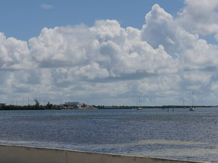 Ocean view of the Key West, Florida with gorgeous clouds on a beautiful day. Фото со стока