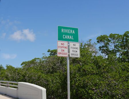 Roadside sign at the Riviera Canal at Key West, Florida.