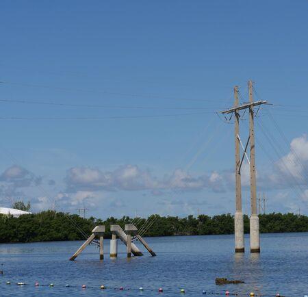 Power poles in the water near a dock