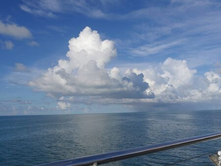 Gorgeous clouds over the ocean, seen from the railings of a ship