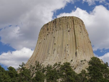 Close upward shot the Devils Tower  in Wyoming, America's first national monument, with breathtaking clouds in the skies.