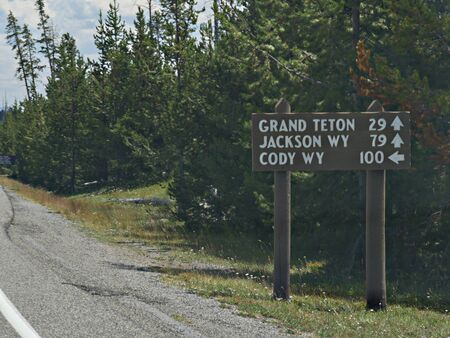 Directional sign on the roadside to the Grand Teton, Jackson and Cody, Wyoming.