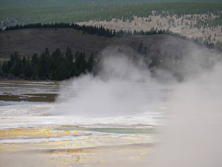 Clepsydra Geyser spews out hot steam at the Lower Geyser Basin, Yellowstone National Park.
