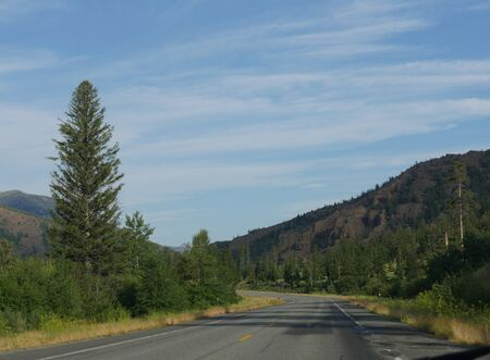Beautiful drive along North Fork Highway toward the east entrance of Yellowstone National Park. Stock Photo