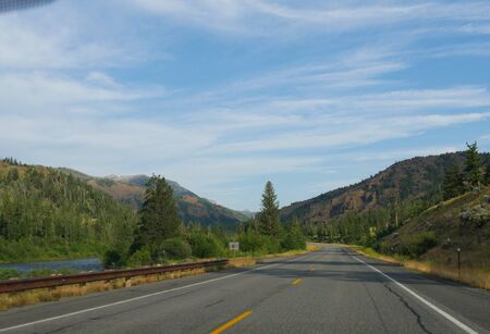 Beautiful drive along North Fork Highway with the North Fork Soshone River flowing, on the road to the east entrance of Yellowstone National Park.