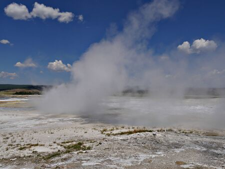 Steam rising from the Clepsydra Geyser at the Lower Geyser Basin, Yellowstone National Park. Reklamní fotografie