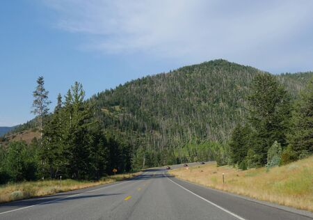 Cody, Wyoming, USA--July 2018: Sloping paved road at North Fork Highway to Yellowstone National Park east entrance. Stock Photo