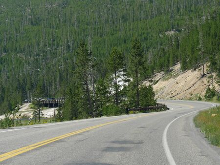 Scenic winding road around the Yellowstone National Park in Wyoming, USA. Stock Photo