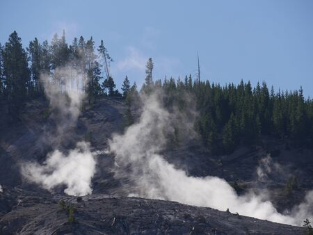 Close up of steam rising from fumaroles at the Roaring Mountain at Yellowstone National Park, Wyoming.