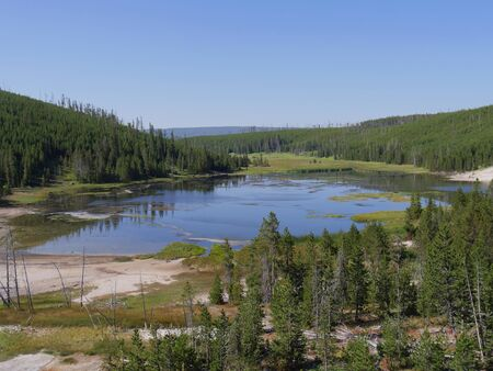 Serene view of Nymph Lake along the road north of Norris Geyser Basin is one of the attractions at Yellowstone National Park. Stock Photo