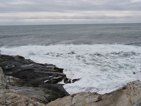 Waves breaking on the rocks at a coastal area in Jamestown, Rhode Island. Stock Photo
