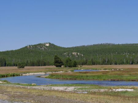 Wide scenic beauty of Yellowstone River flowing through the meadow at Yellowstone National Park, Wyoming.