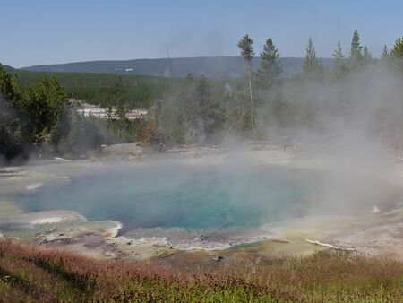 Boiling steaming Emerald Spring at the Norris Geyser Basin at Yellowstone National Park, Wyoming.