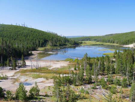 Wide shot of Nymph Lake along the road north of Norris Geyser Basin in Yellowstone National Park. Stock Photo