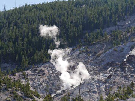 Breathtaking view of the Roaring Mountain with steam spewing from numerous fumaroles at Yellowstone National Park, Wyoming. Stock Photo