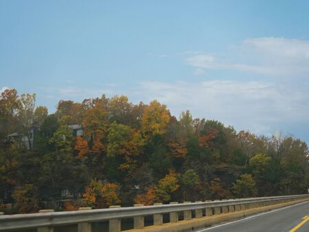 Scenic roadside view with vibrant colors of the trees in autumn in Arkansas, USA. Stock fotó