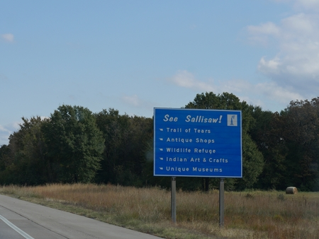 Roadside sign to Sallisaws attractions, Oklahoma.