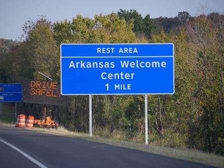 Roadside sign to the Arkansas Welcome Center in Van Buren, Arkansas.