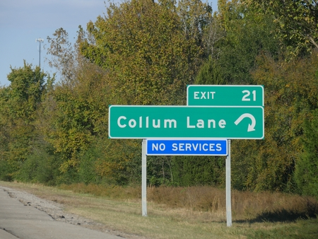 Roadside directional sign along Interstate 49 to Collum Lane in Arkansas, USA.