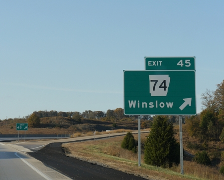 Roadside signs and directions for exit to Winslow at Interstate 49, Arkansas. Sajtókép