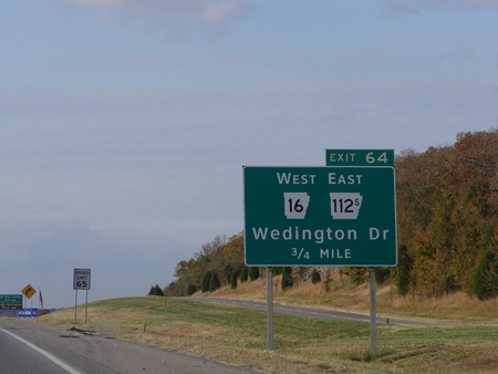 Roadside signs and directions to Wedington Drive along Interstate 49 in Arkansas.