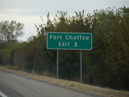 Roadside sign with directions to Fort Chaffee exit in Arkansas, USA.