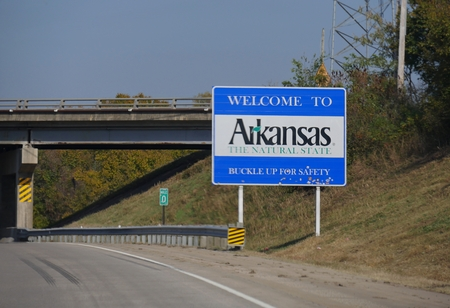 Wide shot of the Welcome to Arkansas welcome sign at Highway 64 past Oklahoma border.
