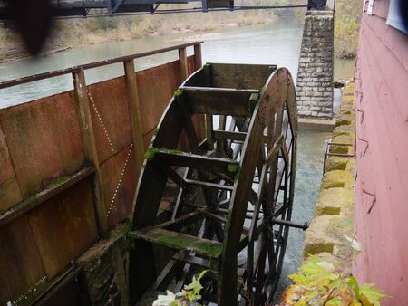 Wide shot of an old but funtional waterwheel in Arkansas Stock Photo