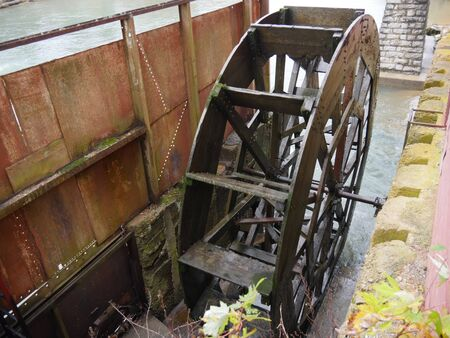 Old traditional Waterwheel spurning water from the river in Arkansas Stock Photo