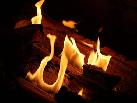 Mesmerizing flame forms from burning logs in a fireplace Stock Photo