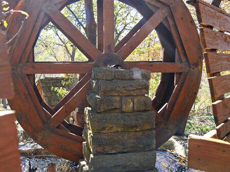 Close up of a wooden waterwheel at a park Banco de Imagens