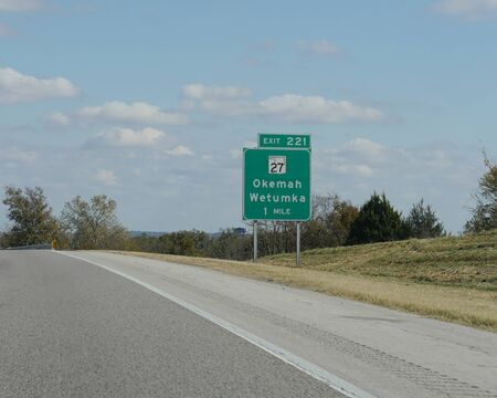 Roadside sign with directions to Okemah and Wetumka in Oklahoma.