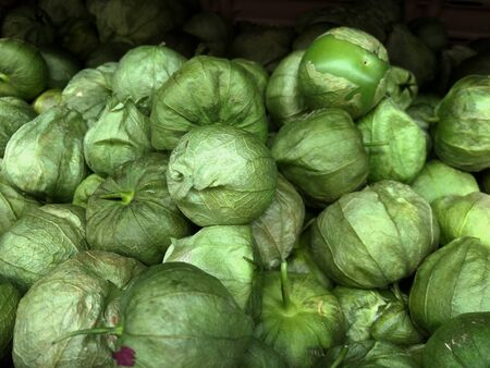 Close up of piles of tomatillos at a fresh produce section