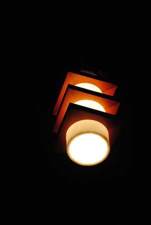 Bright lights from a lampshade in the ceiling