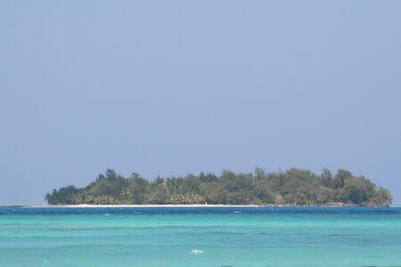 Managaha Island surrounded by blue waters of the Saipan lagoon, Northern Mariana Islands