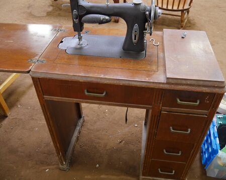 Old fashioned table sewing machine sold at a garage sale