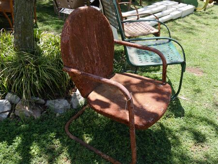Old rusty garden chair sold at a flea market Stock Photo
