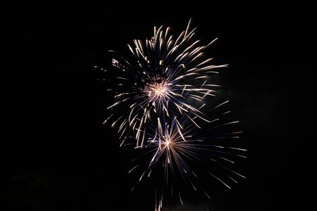 Scattered explosion of fireworks in the skies Stock Photo