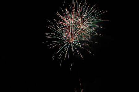 Colorful explosion of fireworks in dark skies