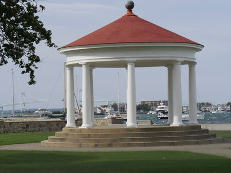 Newport, Rhode Island-September 2017: Wide shot of the gazebo at the King Park Brenton Cove at the Newport Harbor, with boats sailing in the background.