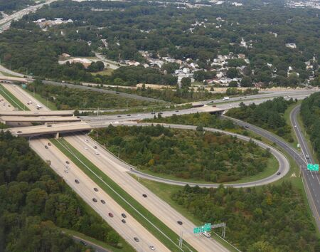 Baltimore, Maryland- September 2017: Vehicles traveling along major highways in Baltimore, aerial view.