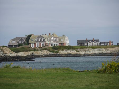 Newport, Rhode Island-September 2017: Big beautiful houses along the Ocean Drive with a pond view.