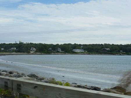 Jamestown, Rhode Island-September 2017: Narragansett Bay with a wooden railing in the foreground.