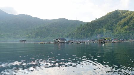 Wide shot of a fishing village with houses on stilts in the southern part of the Philippines.