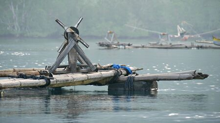 Bamboo raft floating on rubber tires at a fishing village in the southern part of the Philippines.