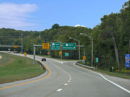 Narragansett, Rhode Island-September 2017: Directional signs at an intersection with arrows to the north and south directions.