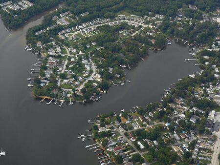 Baltimore, Maryland- September 2017: Scenic aerial view of the Curtis Creek snaking around docks. 스톡 콘텐츠