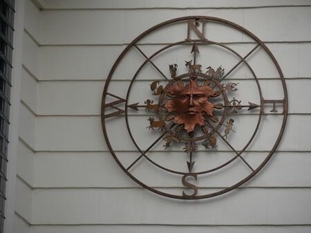 Newport, Rhode Island-September 2017: Close u pof an artistic native compass decoration displayed outside a building at the shopping district in Newport. 스톡 콘텐츠